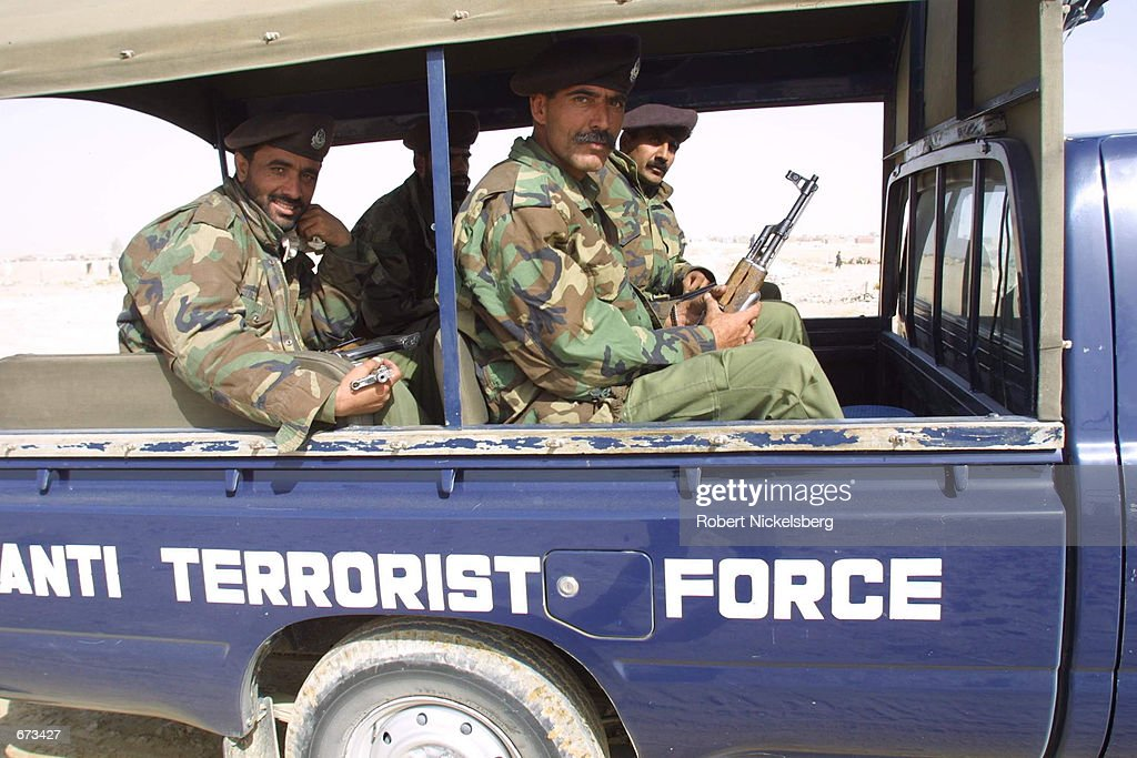 Pakistani anti-terrorist police patrols a refugee camp October 28, 2001in Chaman, Pakistan, right across the border from Afghanistan. The police were present to provide security for the visiting UNHCR High Commissioner, Ruud Lubbers.