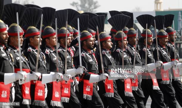 Pakistani armed force soldiers march during a military parade to mark Pakistan's National Day in Islamabad Pakistan on March 23 2017