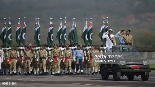 Pakistani armed forces soldiers march past during the Pakistan Day military parade in Islamabad on March 23 2018 Pakistan National Day commemorates...