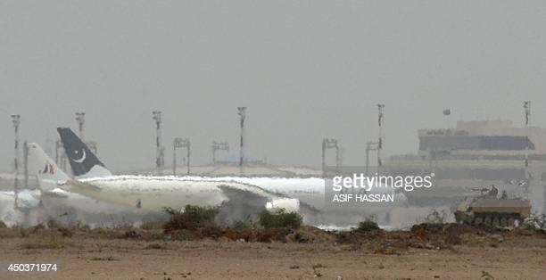 A Pakistani army armoured personnel carrier is pictured amid mirage following a firing incident at the Jinnah International Airport in Karachi on...