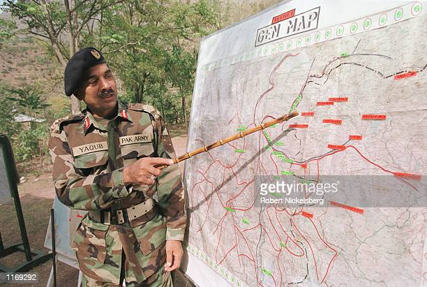 Pakistani Army Brigadier Muhammad Yaqub points to the Indian Army bunker on a map October 20 2001 in Chakoti along the Line of Control on the...