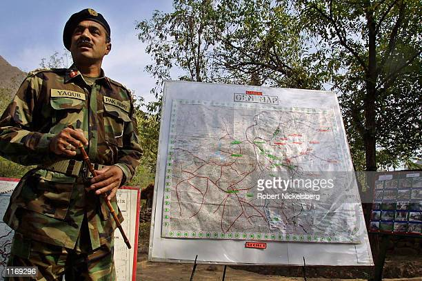 Pakistani Army Brigadier Muhammad Yaqub uses a map to show Indian Army bunkers October 20 2001 in Chakoti along the Line of Control on the...
