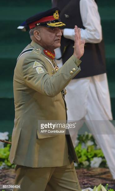 Pakistani Army Chief General Qamar Javed Bajwa arrives to attend a flag hoisting ceremony to mark the country's Independence Day in Islamabad on...