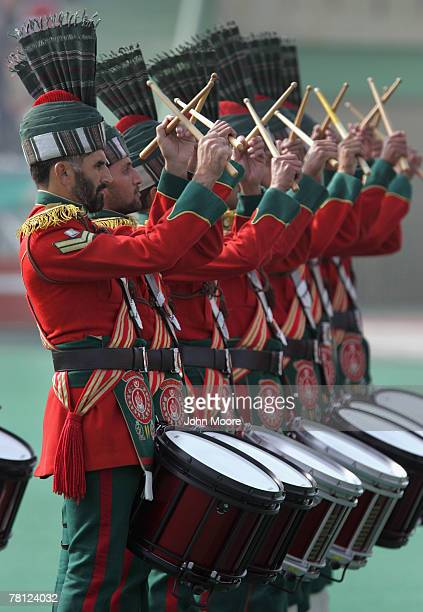 Pakistani army drummers play for President Pervez Musharraf and new army chief Gen Ashfaq Kayani at a change of command ceremony November 28 2007 in...