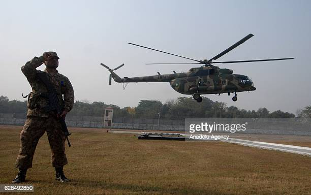 Pakistani army helicopter carrying the bodies of the PIA plane crash victims lands at an helipad in Sports Complex in Islamabad Pakistan on December...