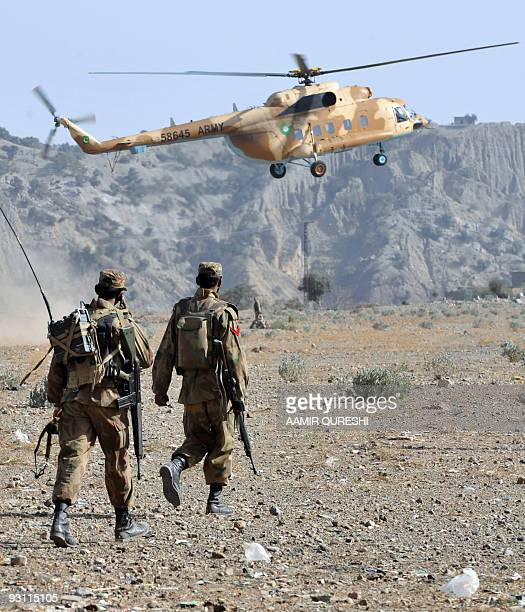 A Pakistani Army helicopter flies as soldiers patrol in Sararogha town which was the stronghold of Taliban militants in troubled South Waziristan on...