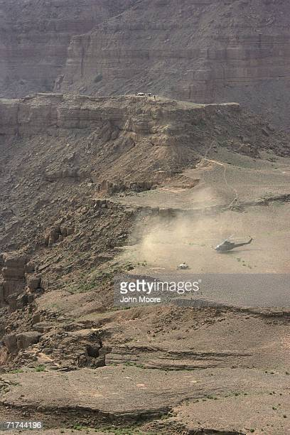 Pakistani army helicopter lands near a cave in a rugged ravine where the army says that the body of Baloch rebel leader Nawab Akbar Bugti lies...