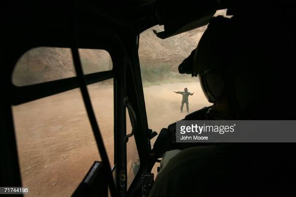 Pakistani army helicopter pilot lands near a cave where the army says that the body of Baloch rebel leader Nawab Akbar Bugti lies beneath the rubble...