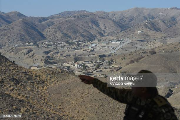 A Pakistani army officer briefs the media about the border terminal in Ghulam Khan a town in North Waziristan on the border between Pakistan and...