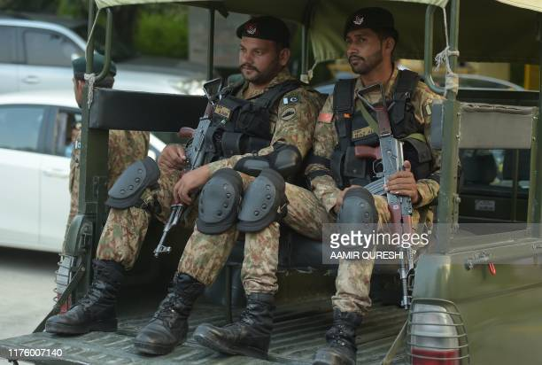 Pakistani Army officer sits in a vehicle prior the arrival of Britain's Prince William Duke of Cambridge and his wife Catherine Duchess of Cambridge...