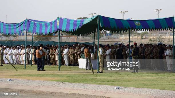 Pakistani army officers and mourners attend funeral of Siraj Raisani a candidate of provincial seat who was killed in Mastung bomb blast in Quetta on...