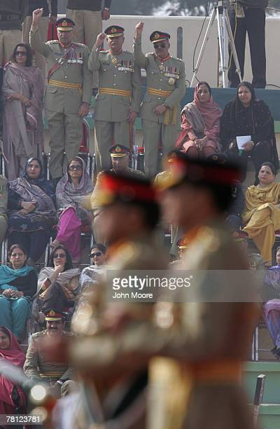 Pakistani Army officers cheer for President Pervez Musharraf and their new army chief Gen Ashfaq Kayani at a change of command ceremony November 28...