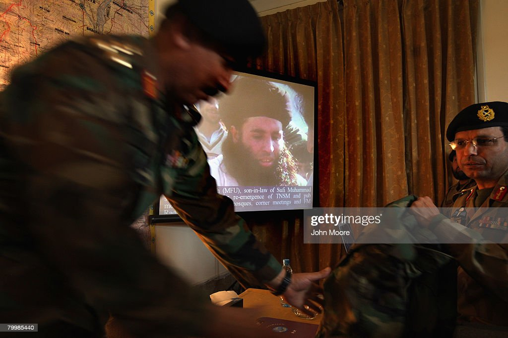 Pakistani Army officers show a photo of radical Islamic Cleric and militant leader Muaulana Fazlullah February 25, 2008 in Mingora in northwestern Pakistan. The army has been battling Islamic militants led by Fazlullah for three months in the area and has taken back large swaths of land which had been controled by insurgents. The country's commitment to the fight against Taliban and Al Qaeda in the region is a major issue between Pakistan and the United States as the country forms a new government following recent national elections.