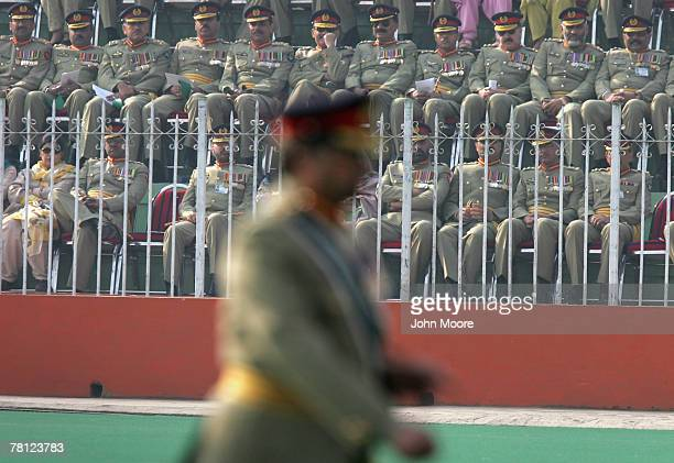 Pakistani army officers watch as President Pervez Musharraf walks off the field at a change of command ceremony November 28 2007 in Rawalpindi...