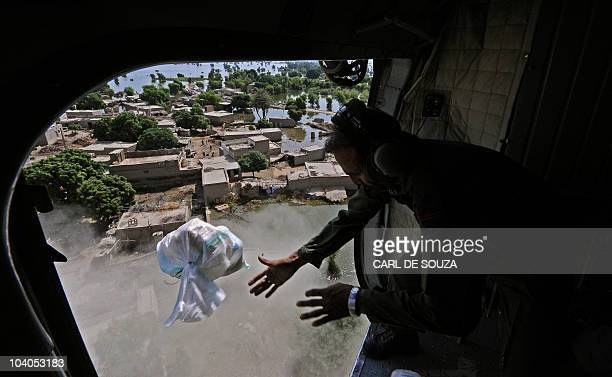 Pakistani army personnel drop aid from a helicopter near Dadu Sindh province Pakistan on September 13 2010 Some 21 million people have been affected...