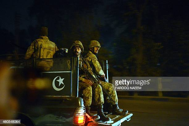 Pakistani army personnel patrol the streets following an attack by Taliban gunmen on a school in Peshawar on December 16 2014 Taliban insurgents...