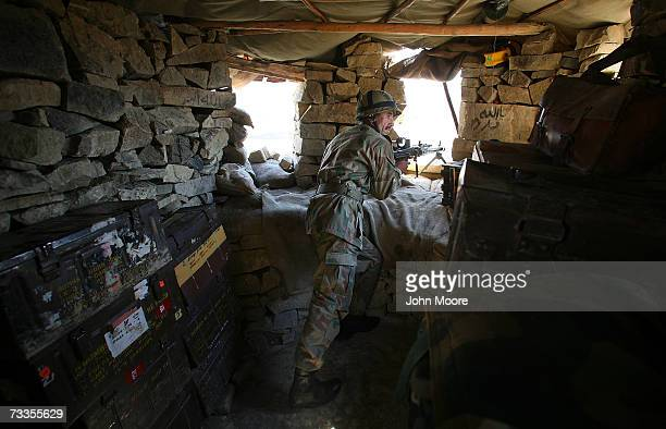 Pakistani Army soldier mans a bunker at a combat outpost near the Afghan border February 17 2007 in the tribal area of North Waziristan Pakistan NATO...