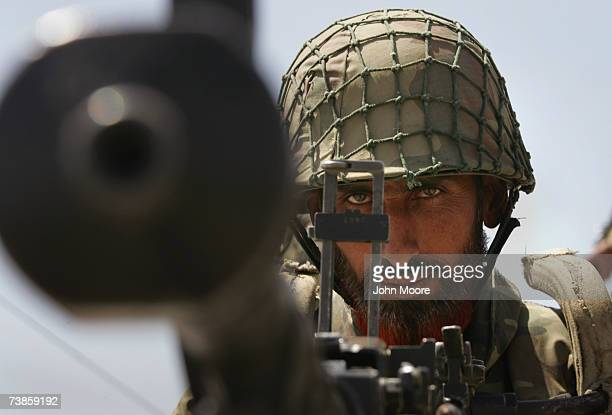 Pakistani army soldier mans a heavy machine gun at a military outpost near Wana April 11 2007 in Pakistan's South Waziristan tribal area near the...