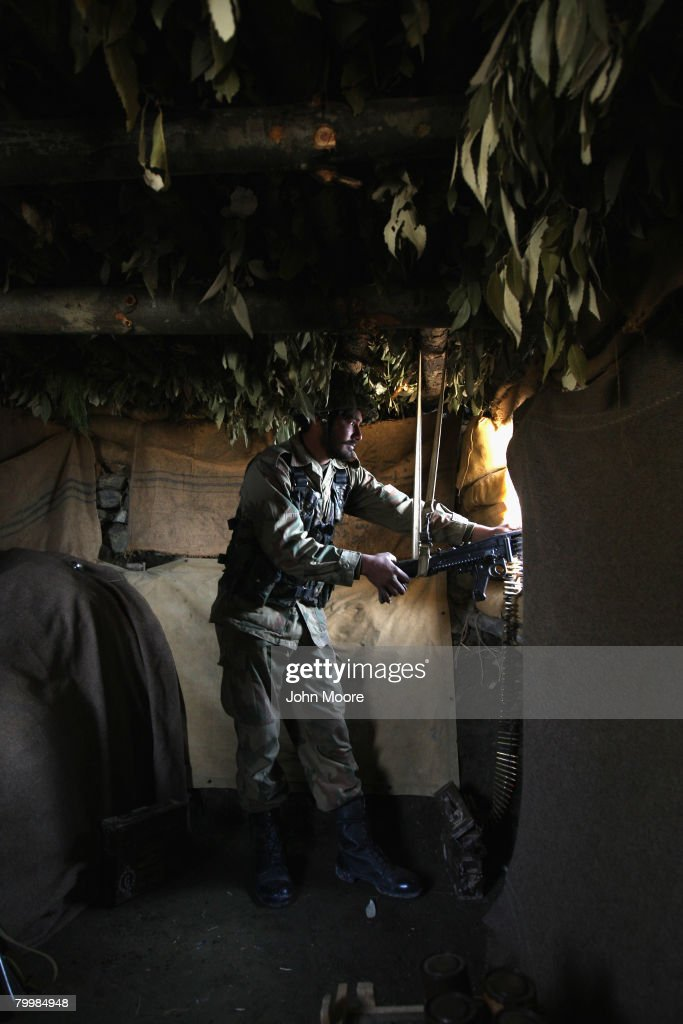 A Pakistani Army soldier mans a machine gun in a bunker on a strategic mountain top February 25, 2008 in Uchrai Sar, northwestern Pakistan. The army has been battling Islamic militants for three months in the area and have taken back large swaths of land which had been controled by insurgents. the country's commitment to the fight against Taliban and Al Qaeda in the region is a major issue between Pakistan and the United States as the country forms a new government following recent national elections.