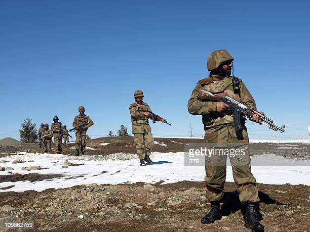 Pakistani army soldier patrol at the mountains area of Pash Ziarat a town of North Waziristan on March 8 2011 Some 4000 people have been killed in...