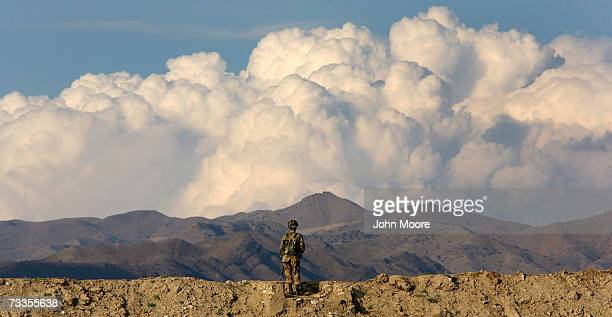 Pakistani Army soldier stands guard at a base in Miran Shah February 17 2007 in the tribal area of North Waziristan Pakistan NATO and the Afghan...