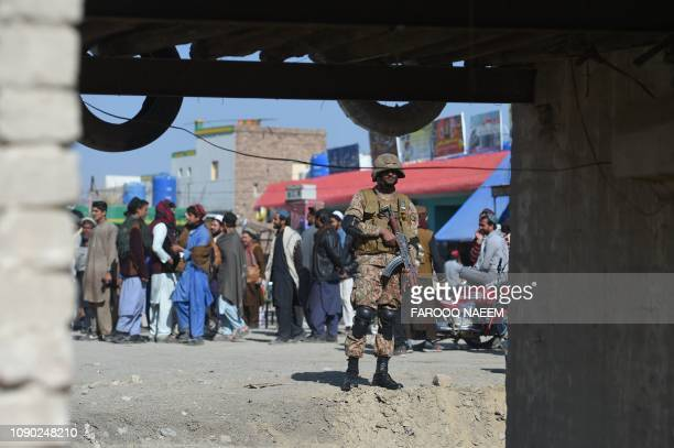 A Pakistani army soldier stands guard at a market in Miran Shah a town in North Waziristan near the border between Pakistan and Afghanistan on...