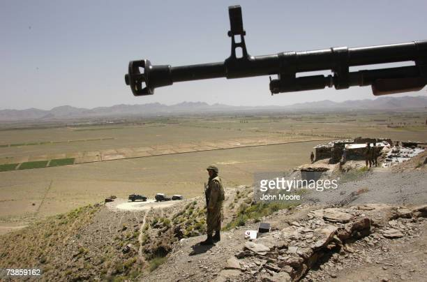 Pakistani Army soldier stands guard at a military outpost near Wana April 11, 2007 in Pakistan's South Waziristan tribal area near the Afghan border....