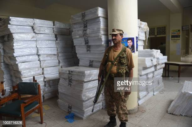A Pakistani army soldier stands guard next to polling materials before handing it over to polling staff in Lahore on July 22 2018 Pakistan will hold...