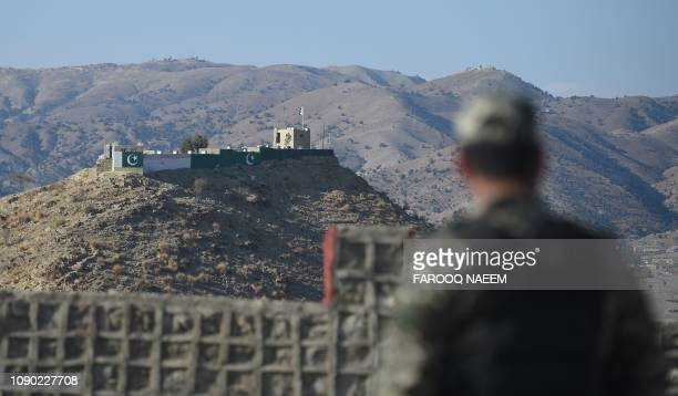 A Pakistani army soldier stands guard on a border terminal in Ghulam Khan a town in North Waziristan on the border between Pakistan and Afghanistan...