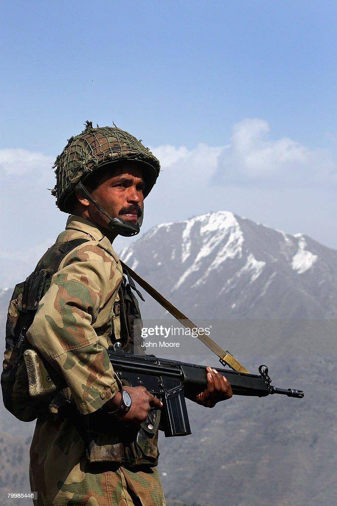 A Pakistani Army soldier stands guard on a strategic mountain top February 25, 2008 in Uchrai Sar, northwestern Pakistan. The army has been battling Islamic militants for months in the area and has taken back large swaths of land which had been controled by insurgents. The country's commitment to the fight against Taliban and Al Qaeda in the region is a major issue between Pakistan and the United States as the country forms a new government following recent national elections.