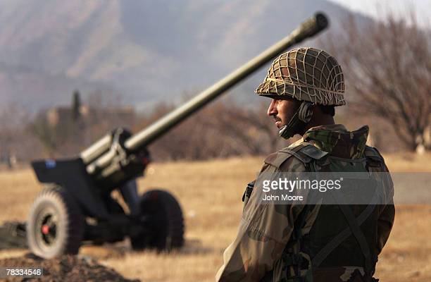Pakistani Army soldier stands near artillery gun used against proTaliban militants while on base at Kabal December 8 2007 in the Swat valley of...