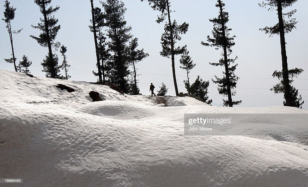 A Pakistani Army soldier walks along on a strategic mountain top February 25, 2008 in in Shangla, northwestern Pakistan. The army has been battling Islamic militants for months in the area and has taken back large swaths of land which had been controled by insurgents. The country's commitment to the fight against Taliban and Al Qaeda in the region is a major issue between Pakistan and the United States as the country forms a new government following recent national elections.