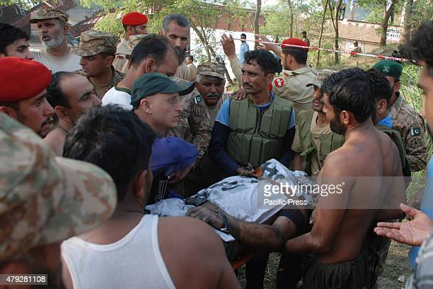 Pakistani Army soldiers and rescue workers try to rescue passengers after a train derailed into a canal near Gujranwala 100 kilometers north of...