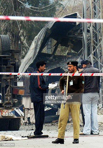 Pakistani army soldiers gather near a destroyed army vehicle after a suicide attack in Rawalpindi on February 4 2008 A suicide attacker rammed a...