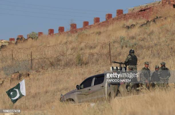 Pakistani army soldiers gather near a vehicle at a border terminal in Ghulam Khan a town in North Waziristan on the border between Pakistan and...