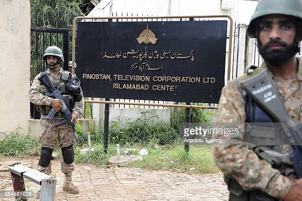 Pakistani army soldiers patrol outside the PTV building after army forces removed the protesters who had been accused of attacking employees and...