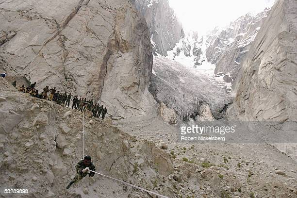 Pakistani Army soldiers perform a mountain river crossing exercise at 13800 feet June 17 2005 in Gyari Pakistan Since 198284 the Pakistani Army has...
