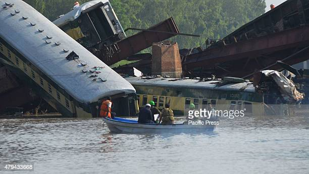 Pakistani Army soldiers rescue workers and troops search the dead bodies of train victims after it derailed into a canal near Gujranwala in the...