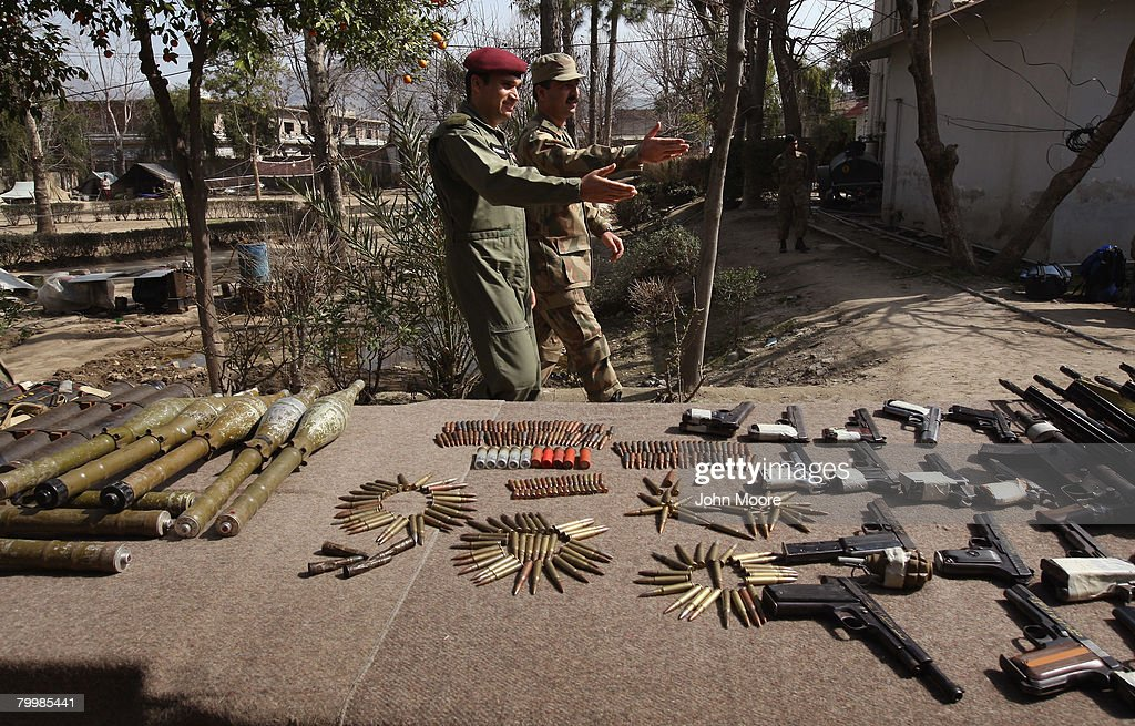 Pakistani Army soldiers show off confiscated weapons February 25, 2008 in Mingora in northwestern Pakistan. The army has been battling Islamic militants for months in the area and has taken back large swaths of land which had been controled by insurgents. The country's commitment to the fight against Taliban and Al Qaeda in the region is a major issue between Pakistan and the United States as the country forms a new government following recent national elections.
