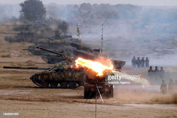 Pakistani Army soldiers show their skills during a military exercise named AzmeNau in Khairpur Tamaiwali on November 4 2013 in Bahawalpur Pakistan...