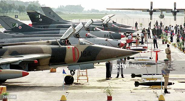 Pakistani army soldiers stand guard in front of Pakistani AirForce fighter planes exhibited at the National Defence Day on chaklala air bass in...