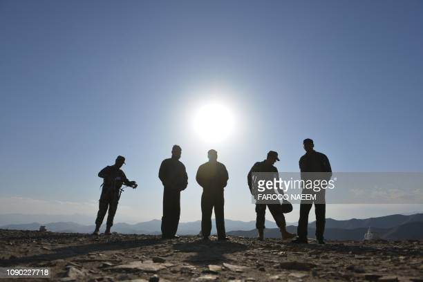 Pakistani army soldiers stand near a border terminal in Ghulam Khan a town in North Waziristan on the border between Pakistan and Afghanistan on...