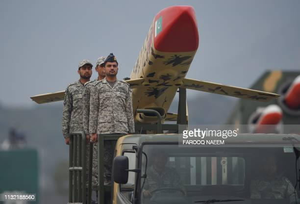 Pakistani army soldiers stand on a vehicle carrying Ra'ad cruise missiles during the Pakistan Day parade in Islamabad on March 23 2019 Pakistan...
