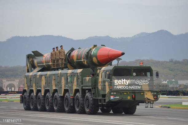 Pakistani army soldiers travel on a vehicle carrying a longrange ballistic Shaheen II missile during the Pakistan Day parade in Islamabad on March 23...