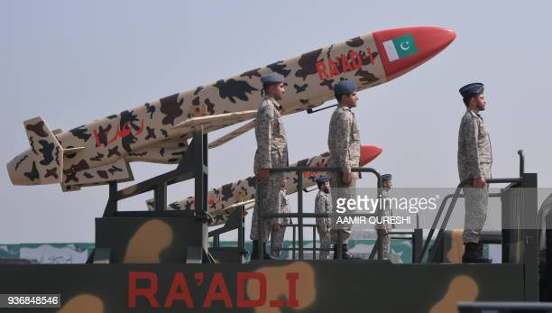 Pakistani army soldiers travel on a vehicle carrying Ra'ad cruise missiles during the Pakistan Day military parade in islamabad on March 23 2018...
