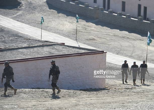 Pakistani army soldiers walk near a border terminal in Ghulam Khan a town in North Waziristan on the border between Pakistan and Afghanistan on...