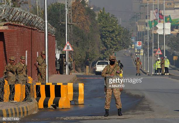 Pakistani army troops cordon off a street leading to the Army Public School due to hold a ceremony to mark the first anniversary of the school...