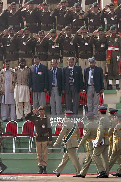 Pakistani army troops give a farewell salute to President Pervez Musharraf at a change of command ceremony on November 28 2007 in Rawalpindi Pakistan...