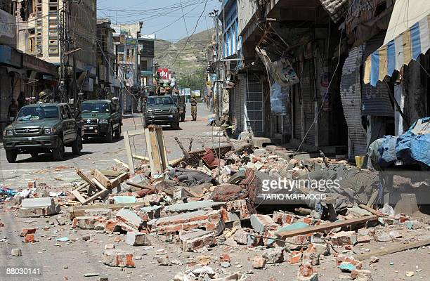 Pakistani army troops patrol a street along the damaged main market area of Mingora the capital of the troubled Swat valley on May 27 2009 A deadly...