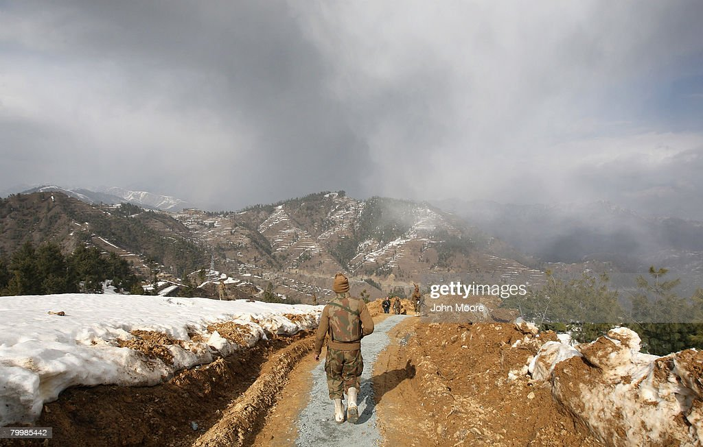 A Pakistani Army walks through a military outpost on a strategic mountain top February 25, 2008 in Shangla, northwestern Pakistan. The army has been battling Islamic militants for months in the area and has taken back large swaths of land which had been controled by insurgents. The country's commitment to the fight against Taliban and Al Qaeda in the region is a major issue between Pakistan and the United States as the country forms a new government following recent national elections.